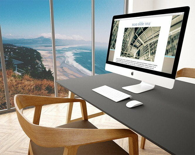 web design example of computer on desk with ocean in background