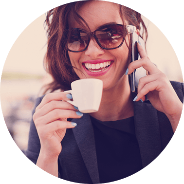 woman on phone drinking cup of coffee